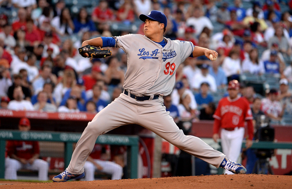 . Los Angeles Dodgers starting pitcher Hyun-Jin Ryu throws to the plate against the Los Angeles Angels in the first inning of a baseball game at Anaheim Stadium in Anaheim, Calif., on Thursday, Aug. 7, 2014.  (Photo by Keith Birmingham/ Pasadena Star-News)