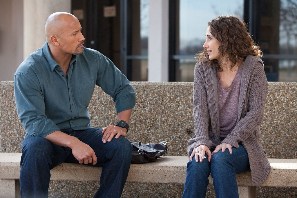 """. This film image released by Summit Entertainment shows Dwayne Johnson, left, and Melina Kanakaredes in a scene from \""""Snitch.\"""" (AP Photo/Summit Entertainment, Steve Dietl)"""