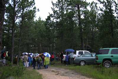 Heavy rain moved in just before 7 o'clock, the tentative start time for the walk.  Fortunately, the downpour was brief -- as were the clashes of thunder -- and we would soon be on the trail.  Warm clothing, rain gear, and good hiking boots are real assets for regulars on the Moon Walks.