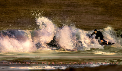 A surfer rides the curls on a glorious January afternoon in the Bay Area, Baker Beach, San Francisco.