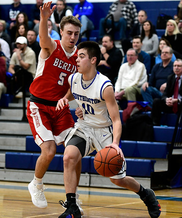 2/21/2019 Mike Orazzi | Staff Berlin High School's Ryan Hyde (5) and Southington's Jared Kelly (10) during the CCC Boys Basketball Tournament in Southington Thursday night.