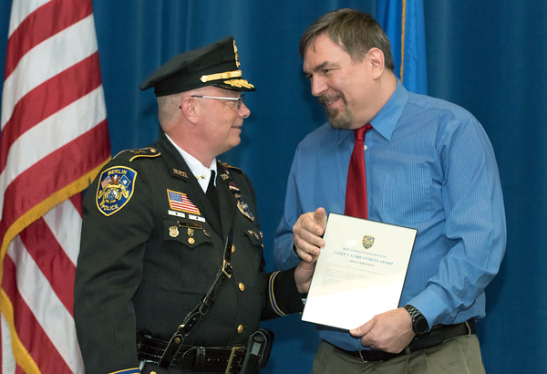 05/15/18 Wesley Bunnell | Staff Berlin Police held their 2018 Awards Ceremony on Tuesday May 15th at Eversource Energy at 107 Selden St. IT Specialist Brian Freeman receives the Chief's Award from Chief John Klett.