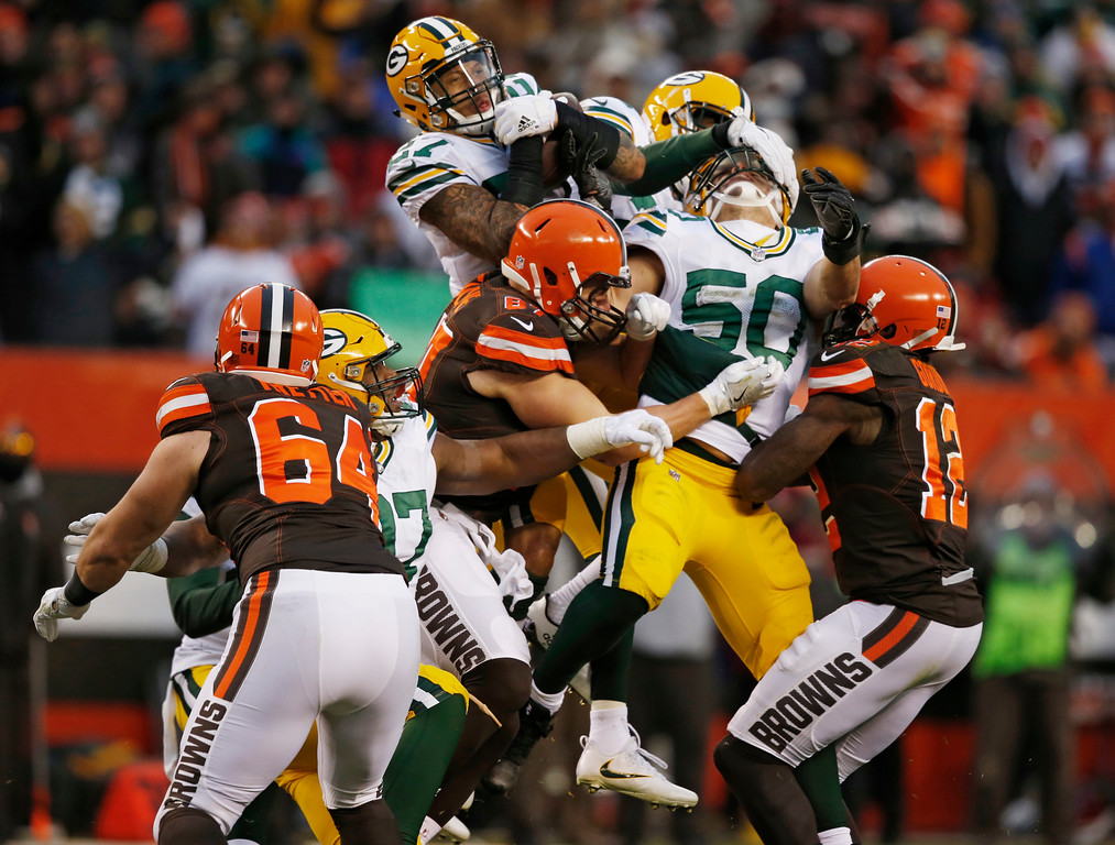 . Green Bay Packers strong safety Josh Jones, top center, catches an interception in the second half of an NFL football game against the Cleveland Browns, Sunday, Dec. 10, 2017, in Cleveland. The Packers won 27-21. (AP Photo/Ron Schwane)