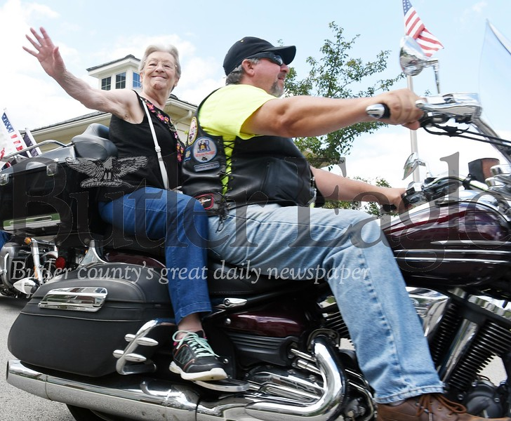 Harold Aughton/Butler Eagle: Frances Lavrinc, 82, of Zelienople takes a ride with John Campbell of the American Legion Riders, Post 474, Saturday, August 10