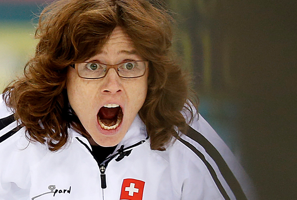 . Switzerland\'s skip Mirjam Ott shouts instructions to her team during the women\'s curling competition against Britain at the 2014 Winter Olympics, Saturday, Feb. 15, 2014, in Sochi, Russia. (AP Photo/Wong Maye-E)
