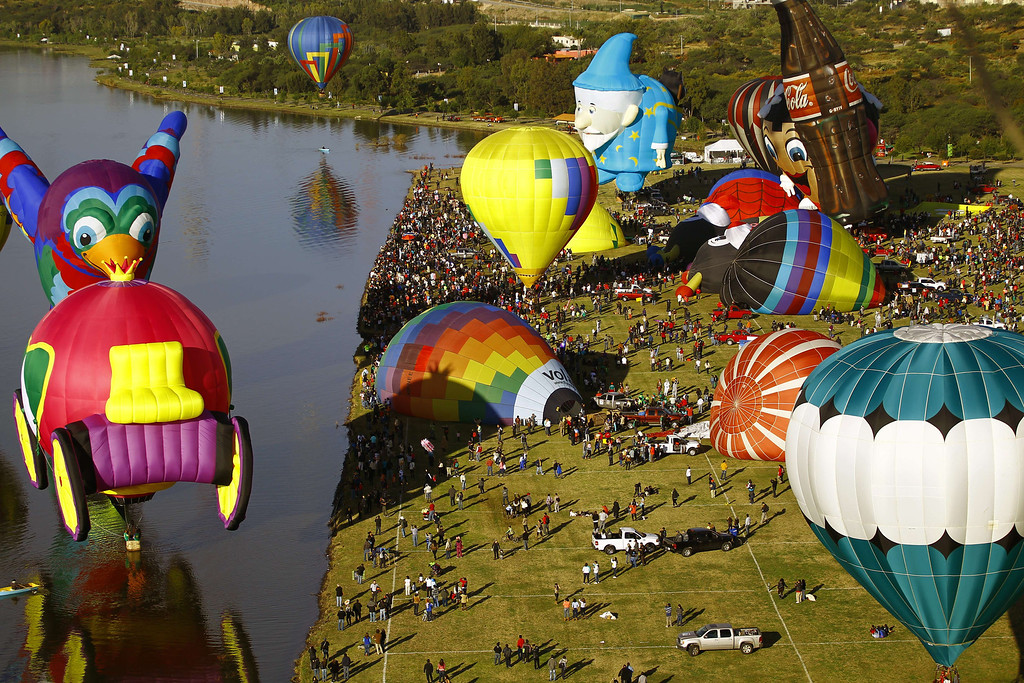 . Hot air balloons stand by to fly during the International Balloon Festival at the Metropolitan Park in Leon, Guanajuato state, Mexico on November  15, 2013. Around 200 balloonists from 16 different countries take part in the festival.  AFP PHOTO/Hector GUERRERO/AFP/Getty Images