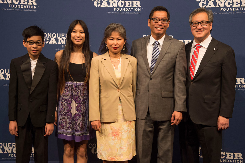 Quyen Chu, MD, and family during Opening Session