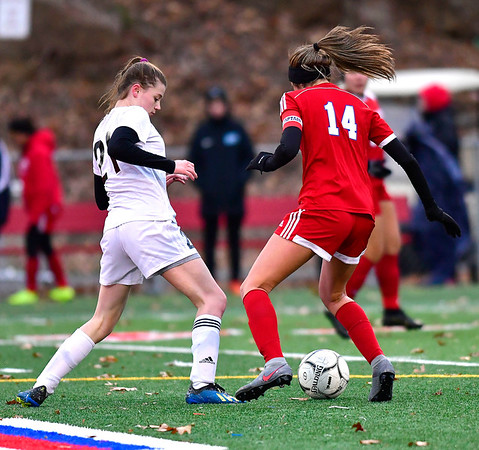11/12/2019 MIke Orazzi | Staff Joel Barlow High School's Emily Mulhern (21) and Berlin High School's Emma Norton (14) during the Class L First Round Girls Soccer Tournament with Joel Barlow in Sage Park in Berlin.