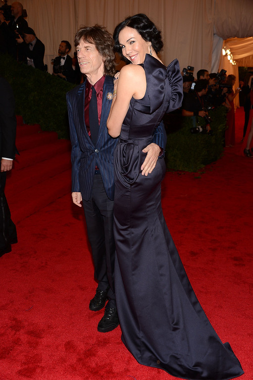 ". Mick Jagger and designer L\'Wren Scott attends the ""Schiaparelli And Prada: Impossible Conversations\"" Costume Institute Gala at the Metropolitan Museum of Art on May 7, 2012 in New York City.  (Photo by Dimitrios Kambouris/Getty Images)"