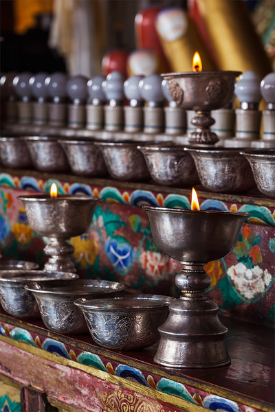 Lamps and Tibetan Water Offering Bowls in Thiksey monastery. Ladadkh, India