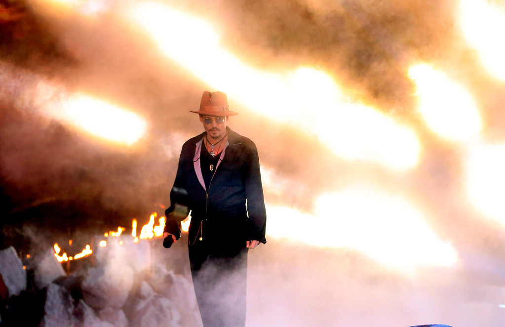 . Actor Johnny Depp speaks onstage at the 2014 MTV Movie Awards at Nokia Theatre L.A. Live on April 13, 2014 in Los Angeles, California.  (Photo by Frederick M. Brown/Getty Images)