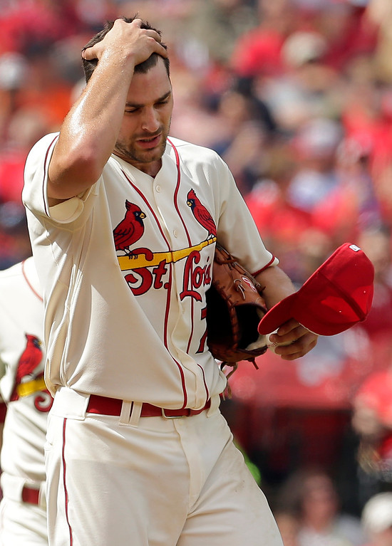 . St. Louis Cardinals starting pitcher Tyler Lyons walks back to the mound after giving up an RBI single to Detroit Tigers\' Yoenis Cespedes during the third inning of a baseball game, Saturday, May 16, 2015, in St. Louis. (AP Photo/Jeff Roberson)
