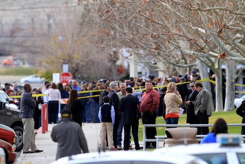 . Parents, staff and people from law enforcement stand in front of Taft Union High School in Kern County, California, on Thursday, January 10, 2013, after a student opened fire in a classroom. (Irfan Khan/Los Angeles Times/MCT)