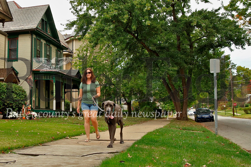 Kellie Wright of Butler walks her dog Max down McKean St. south of E. Fulton Thursday. Seb Foltz/Butler Eagle