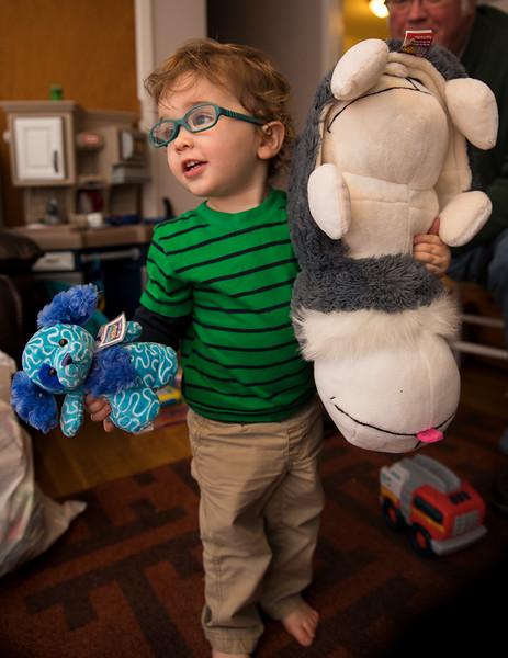 Caleb with Stuffed animals.jpg