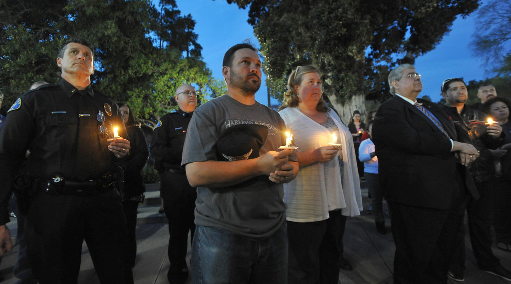 . Residents gather for a community-wide prayer vigil at Central Park in Whittier in response to recent attempted child abductions on Friday March 15, 2013. About 150 people attended the candlelight vigil led by Pastor Sam Gamboa of the Good Shepherd Family Bible Church and organized by the Whittier Area Evangelical Ministerial Alliance. City and police officials joined citizens and area church members as they prayed for protection of the children and the arrest of the suspects. (SGVN/Staff Photo by Keith Durflinger)