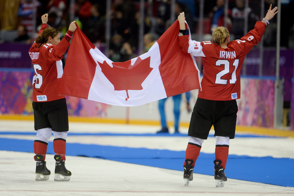 . SOCHI, RUSSIA - FEBRUARY 20: Jayna Hefford (16) of the Canada and Haley Irwin (21) celebrate the overtime period of Canada\'s 3-2 gold medal ice hockey win over the U.S.A. Sochi 2014 Winter Olympics on Thursday, February 20, 2014 at Bolshoy Ice Arena. (Photo by AAron Ontiveroz/ The Denver Post)