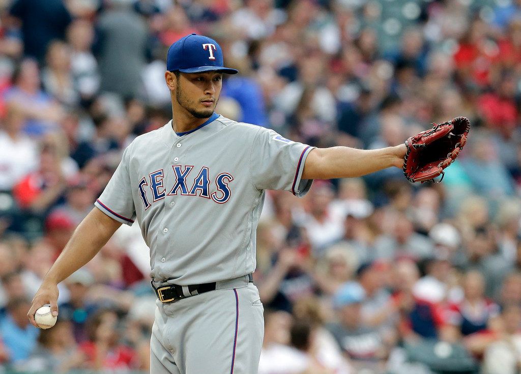 . Texas Rangers starting pitcher Yu Darvish points toward second baseman during the third inning of a baseball game against the Cleveland Indians, Wednesday, June 28, 2017, in Cleveland. (AP Photo/Tony Dejak)