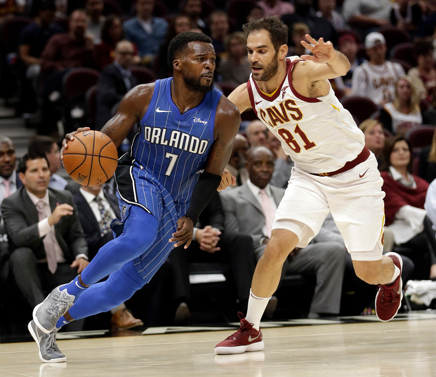 . Orlando Magic\'s Shelvin Mack (7) drives past Cleveland Cavaliers\' Jose Calderon (81), from Spain, in the second half of an NBA basketball game, Saturday, Oct. 21, 2017, in Cleveland. (AP Photo/Tony Dejak)