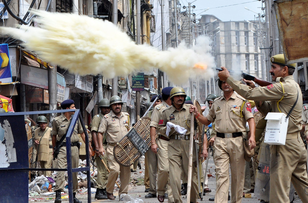 . An Indian policeman fires a teargas shell during a clash between protestors and Indian police officials in Jammu on August 10, 2013.  A town in the south of Indian Kashmir was under curfew for a second day after two people were killed and dozens wounded in Hindu-Muslim clashes in the disputed Himalayan region, police said. Stores and buildings were torched in the clashes on August 9, which erupted in Kishtwar town, 150 kilometres (90 miles) southeast of Kashmir\'s summer capital Srinagar after prayers marking the end of Ramadan. AFP PHOTO/STRSTRDEL/AFP/Getty Images
