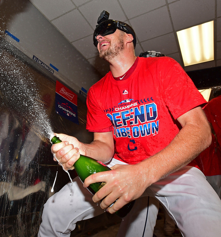 . Cleveland Indians starting pitcher Trevor Bauer celebrates in the clubhouse after the Indians defeated the Detroit Tigers 15-0 to clinch the American League Central Division, in a baseball game, Saturday, Sept.15, 2018, in Cleveland. (AP Photo/David Dermer)