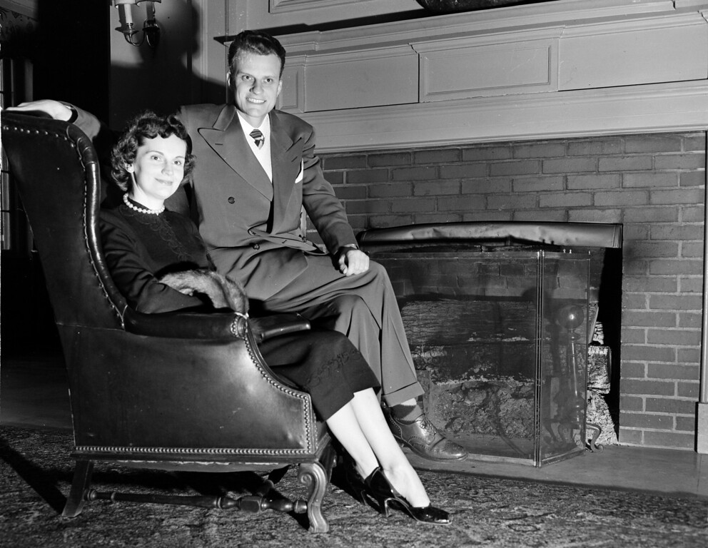 . Evangelical preacher Billy Graham and his wife Ruth sit by the fireplace at the Carolina Inn in Chapel Hill, N.C., Feb. 8, 1951.  The noted evangelist is a native of North Carolina and makes his home in Montreat, N.C.  (AP Photo/Rudolph Faircloth)