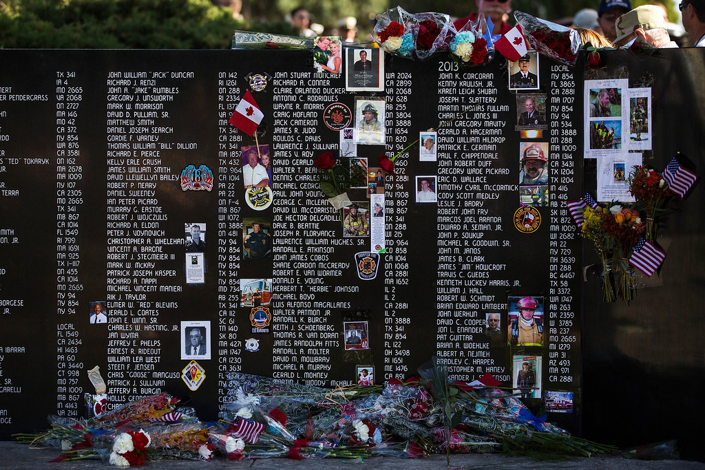 . The IAFF Fallen Fire Fighter Memorial is seen adorned with flowers, pictures and moments at Memorial Park in Colorado Springs, Colo., on Saturday, Sept. 21, 2013.(AP Photo/The Gazette, Kent Nishimura)