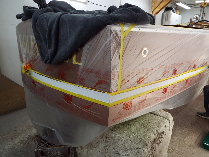 Transom and the starboard side water line painted.