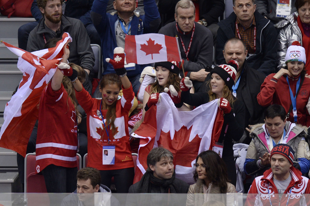 . Canada\'s supporters cheer during the Men\'s Ice Hockey Semifinals USA vs Canada at the Bolshoy Ice Dome during the Sochi Winter Olympics on February 21, 2014. Canada won 0-1.   ALEXANDER NEMENOV/AFP/Getty Images