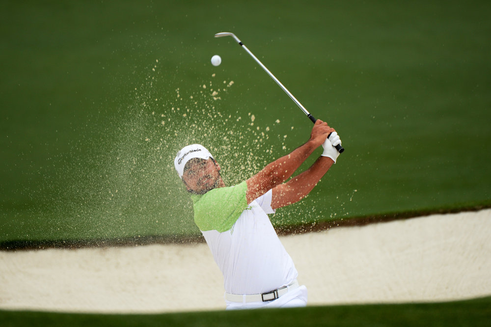 . Jason Day of Australia hits the ball out of the bunker for an eagle on the second hole during the final round of the 2013 Masters Tournament at Augusta National Golf Club on April 14, 2013 in Augusta, Georgia.  (Photo by Harry How/Getty Images)