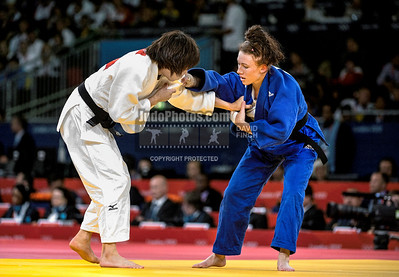2012 London Olympic Judo 120728A9307 Saturday: Kelly Edwards of Great Britain (blue) lost her first contest by ippon against the favourite for the gold medal, Tomoko Fukumi.......
