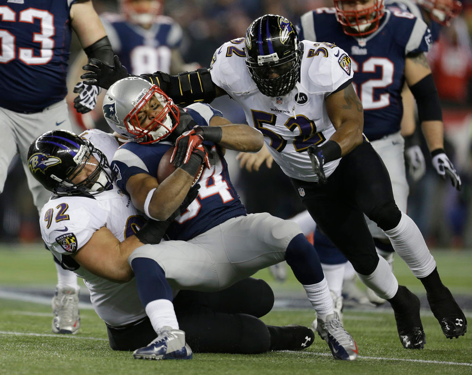 . New England Patriots running back Shane Vereen (34) is tackled by Baltimore Ravens defensive end Haloti Ngata (92) and Ray Lewis (52) during the first half of the NFL football AFC Championship football game in Foxborough, Mass., Sunday, Jan. 20, 2013. (AP Photo/Steven Senne)