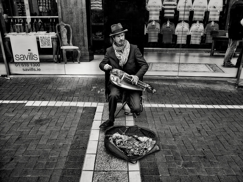 Musician and his Hurdy gurdy on the streets of Dublin Town.