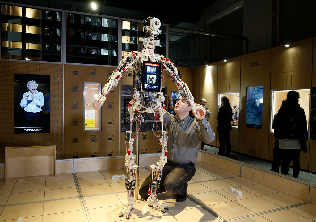 . A technician adjusts Rob\'s Open Source Android (ROSAL) which was built in France from 2010-2016, during a press preview for the Robots exhibition held at the Science Museum in London, Tuesday, Feb. 7, 2017. The exhibition which shows 500 years of mechanical and robotic advances is open to the public form Feb. 8 through to Sept. 3. (AP Photo/Alastair Grant)