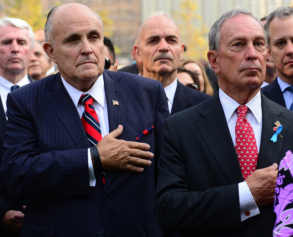 . Former New York CIty Mayor Rudy Giuliani (2nd L) and New York CIty Mayor Michael Bloomberg (2nd R) hold their hands over thier hearts at the 9/11 Memorial during ceremonies for the twelfth anniversary of the terrorist attacks on lower Manhattan at the World Trade Center site on September 11, 2013 in New York City. (Photo by David Handschuh-Pool/Getty Images)