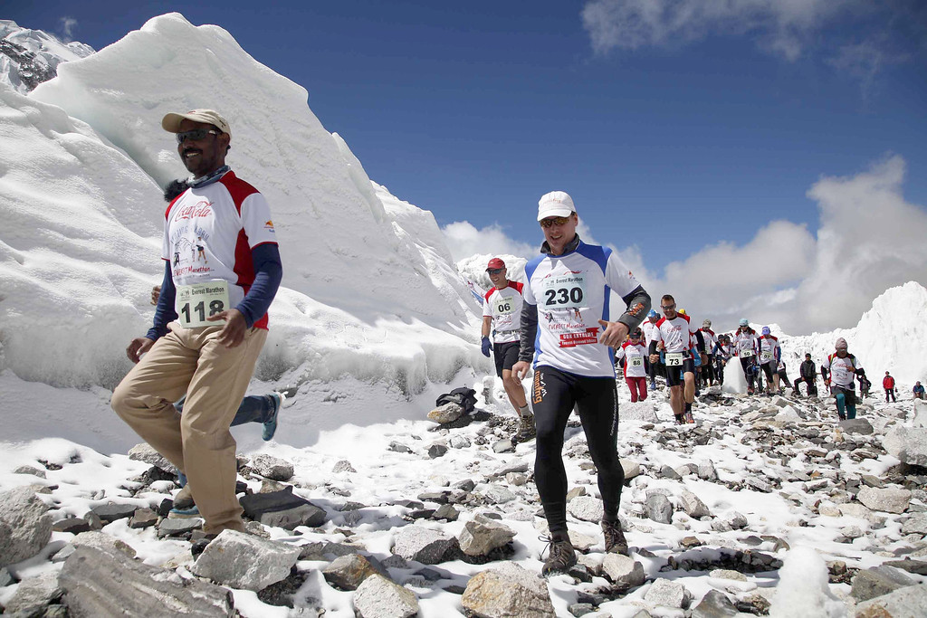 . Participants of the Tenzing Hillary Everest Marathon begin their race at the Everest base camp in the Khumbu region of the Nepal Himalayas, Wednesday, May 29, 2013. Nepal celebrated the 60th anniversary of the conquest of Mount Everest on Wednesday by honoring climbers who followed in the footsteps of Edmund Hillary and Tenzing Norgay. (AP Photo/Himex Nepal, Dinesh Gole)