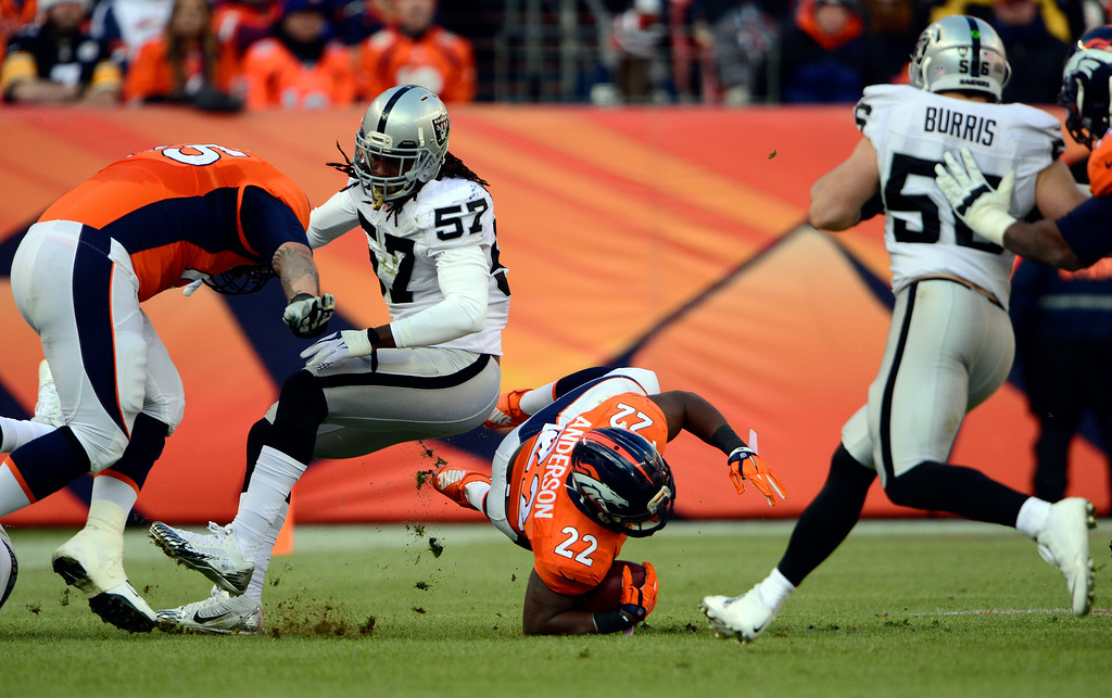 . DENVER, CO - DECEMBER 28: C.J. Anderson (22) of the Denver Broncos gains three yards in the first quarter.  The Denver Broncos played the Oakland Raiders at Sports Authority Field at Mile High in Denver on December, 28 2014. (Photo by Joe Amon/The Denver Post)