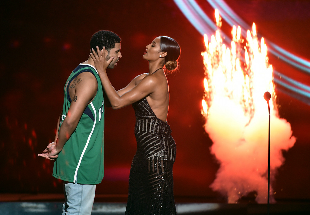 . Skylar Diggins and Drake, left, stand on stage at the ESPY Awards at the Nokia Theatre on Wednesday, July 16, 2014, in Los Angeles. (Photo by John Shearer/Invision/AP)