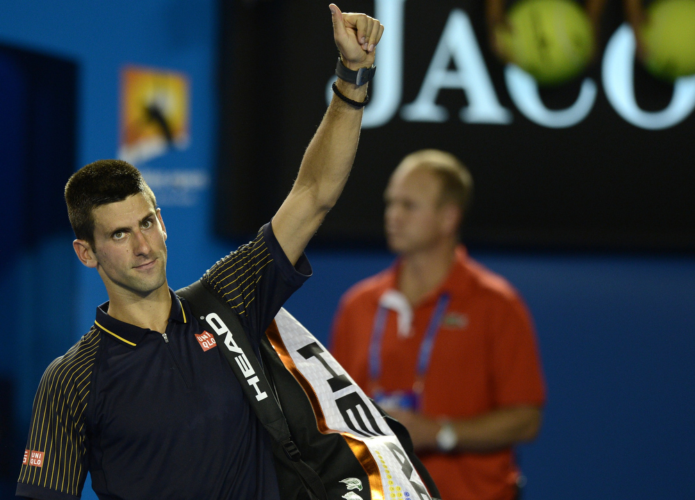 Description of . Serbia's Novak Djokovic acknowledges the crowd after his victory against Spain's David Ferrer during their men's singles semi-final match on day 11 of the Australian Open tennis tournament in Melbourne on January 24, 2013.  MANAN VATSYAYANA/AFP/Getty Images