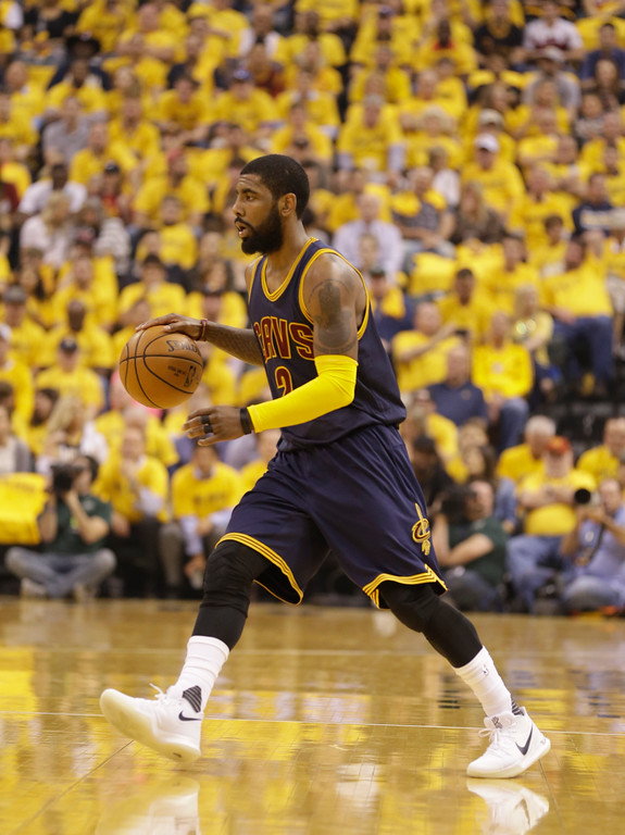 . Cleveland Cavaliers\' Kyrie Irving in action during the first half in Game 3 of a first-round NBA basketball playoff series against the Indiana Pacers,Thursday, April 20, 2017, in Indianapolis. (AP Photo/Michael Conroy)