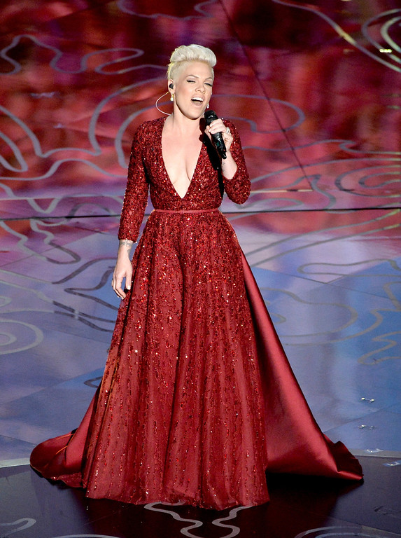 . Singer Pink performs onstage during the Oscars at the Dolby Theatre on March 2, 2014 in Hollywood, California.  (Photo by Kevin Winter/Getty Images)