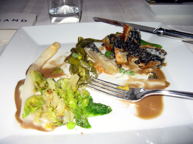 """Craig's """"vegetarian"""" entree at Restaurant Sand in Hoek van Holland.  The waiter said the couscous was colored with """"squirrel ink,"""" which actually turned out to be """"squid ink.""""  Neither are vegetarian."""