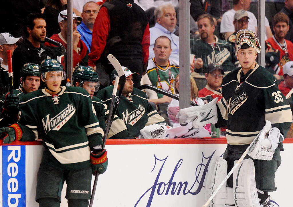 . Minnesota\'s Jared Spurgeon, left, and goalie Darcy Kuemper, right, hang near their bench late in the third period of the Wild\'s 3-0 loss to the Blackhawks in Game 4 of their Western Conference quarterfinal game at Xcel Energy Center in St. Paul on Tuesday May 7, 2013. (Pioneer Press: John Autey)