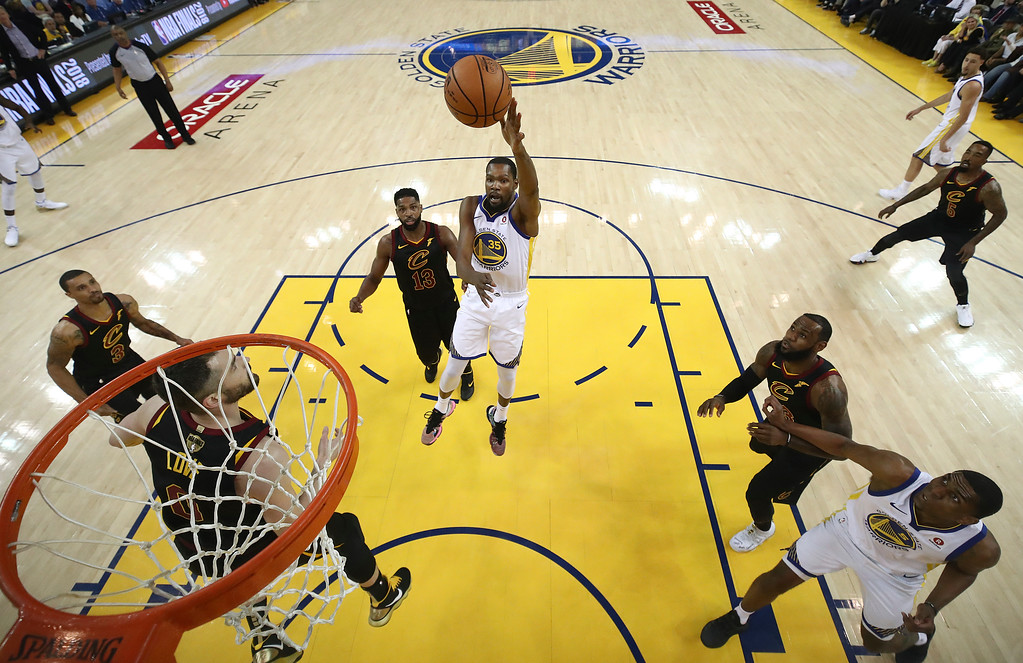 . Golden State Warriors forward Kevin Durant (35) shoots against the Cleveland Cavaliers during the first half of Game 1 of basketball\'s NBA Finals in Oakland, Calif., Thursday, May 31, 2018. (Ezra Shaw/Pool Photo via AP)