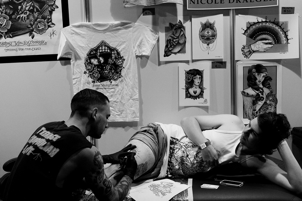 . A man is tattooed during The Australian Tattoo & Body Art Expo at the Royal Hall of Industries, Moore Park on March 8, 2013 in Sydney, Australia. The annual three day event showcases some of Australia\'s best tattoo and body artists and is open to enthusiasts March 8-10.  (Photo by Lisa Maree Williams/Getty Images)