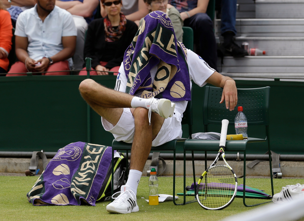 . Jerzy Janowicz of Poland sits in his chair during a change of ends break as he plays Jurgen Melzer of Austria during their Men\'s singles match at the All England Lawn Tennis Championships in Wimbledon, London, Monday, July 1, 2013. (AP Photo/Anja Niedringhaus)