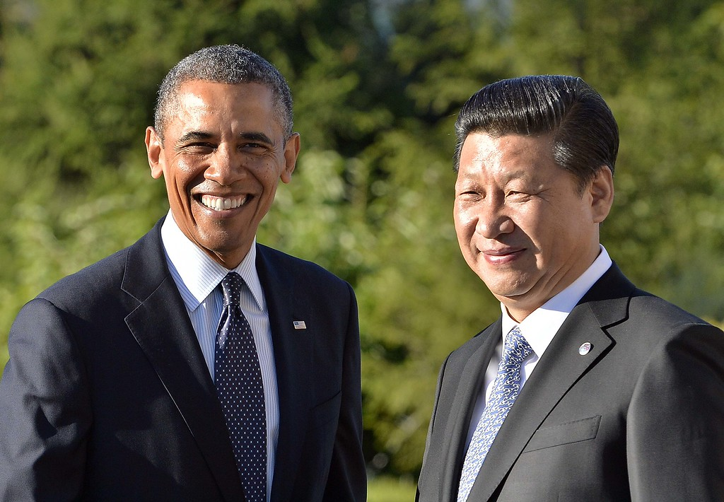 . US President Barack Obama (L) is greeted by Chinese President Xi Jinping for a bilateral meeting in Saint Petersburg on September 6, 2013 on the sideline of the G20 summit. World leaders met at the G20 summit in Russia as tensions over the Syrian conflict threatened to torpedo the work plan of the summit.  JEWEL SAMAD/AFP/Getty Images