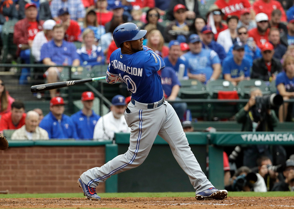. Toronto Blue Jays\' Edwin Encarnacion hits a solo home run off of Texas Rangers\' Yu Darvish in the fifth inning of Game 2 of baseball\'s American League Division Series, Friday, Oct. 7, 2016, in Arlington, Texas. (AP Photo/David J. Phillip)