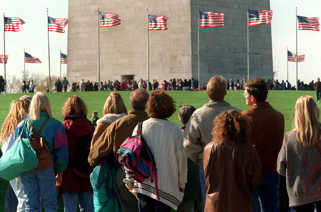 . Washington Monument visitors wait for tickets, foreground, as those with ticket enter the monument, Friday Nov. 10, 1995 in Washington. Despite internal Republican differences, the House labored Friday to adopt temporary spending and borrowing bills, setting up a veto showdown with President Clinton next week. The last time the government shutdown in Oct.1990, all museums and monuments were closed. (AP Photo/Denis Paquin)