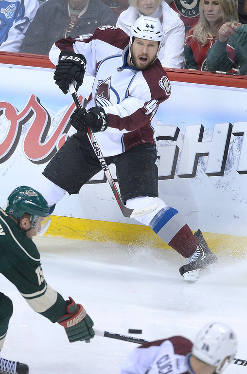 . Colorado defenseman Ryan Wilson moved the puck in the third period.  (Photo by Karl Gehring/The Denver Post)